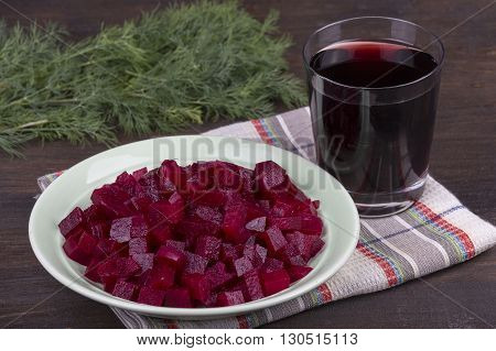 Fresh segments of a beet and beetroot juice close up