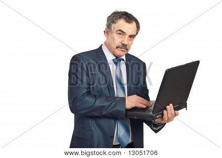 Mature Executive Man Using Laptop
