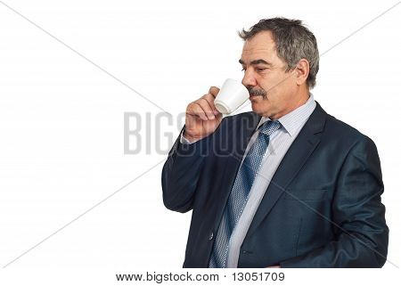 Middle Aged Business Man Drinking Coffee