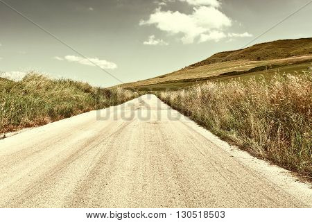 Winding Asphalt Road between Fields of Sicily Retro Image Filtered Style