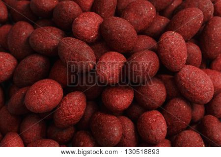 Large bunch of red sweet candy background - studio shot