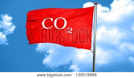 CO2 warning sign, 3D rendering, a red waving flag