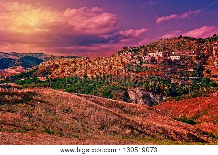 The Typical Sicilian Medieval Town on the Top of the Mountain at Sunset