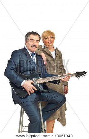 Mature Couple Playing Guitar