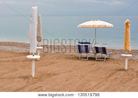 Beach Umbrella and Sun Bed in the Sandy Coast near the Italian City of Minori
