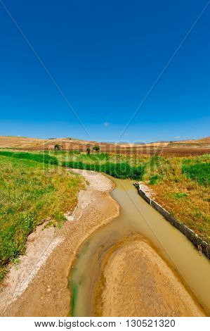 The Mountain River between Hills of Sicily