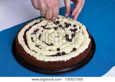 Decorating Red velvet cake on blue background