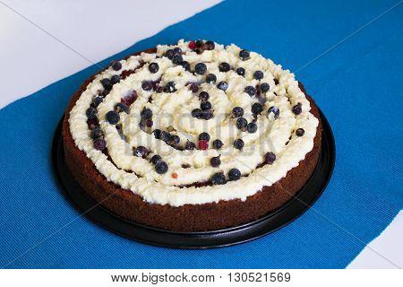 Red velvet cake on blue background, creamy
