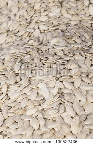 The dried white salted pumpkin seeds background