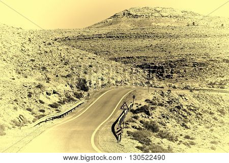 Winding Asphalt Road in the Negev Desert in Israel Retro Image Filtered Style