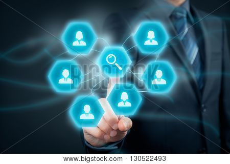 Human resources officer looking for (search) employees. Businessman click on loupe (magnifying glass) to find the best employee for his team.