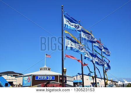 SAN FRANCISCO, USA - MAY 08, 2016: San Francisco Destination Pier 39 Sign and flags, United States Flag