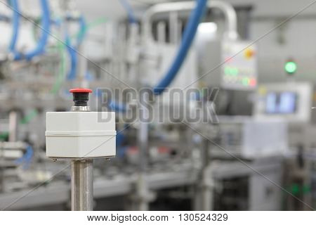 start - stop button on industrial device in plant