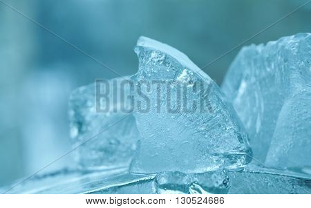 Frozen ice cubes gems. abstract crystal blue background. macro view