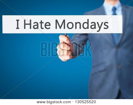 I Hate Mondays - Businessman Hand Holding Sign