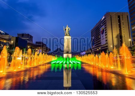 SEOUL SOUTH KOREA - APRIL 30 2016:Beautifully color water fountain at Gwanghwamun Plaza with the statue of the Admiral Yi Sun-sin in downtown.Photo taken on April 302016 in seoulSouth Korea.