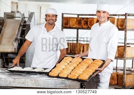 Confident Male Baker's With Baking Trays