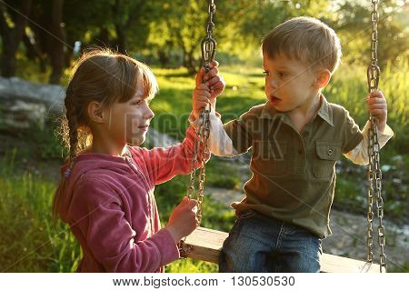 a very happy childrens on a swing
