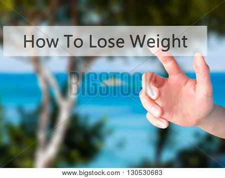 How To Lose Weight - Hand Pressing A Button On Blurred Background Concept On Visual Screen.