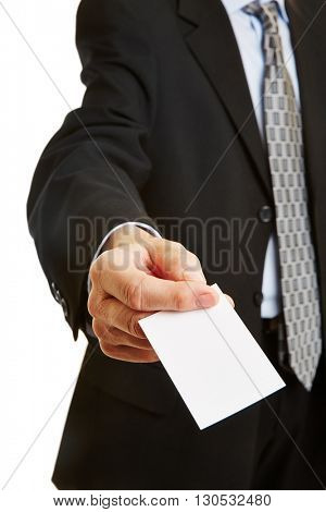 Businessman offering empty white business card with his hand