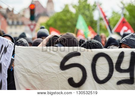Grouop With Covered Face During Protest