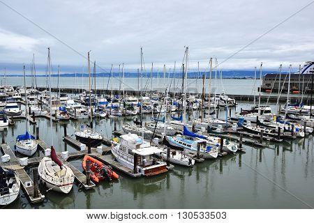 SAN FRANCISCO, USA - MAY 08, 2016: Yacht and sailboats docked at Pier 39 in San Francisco, California, USA.