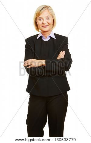 Old female senior as smiling businesswoman with her arms crossed