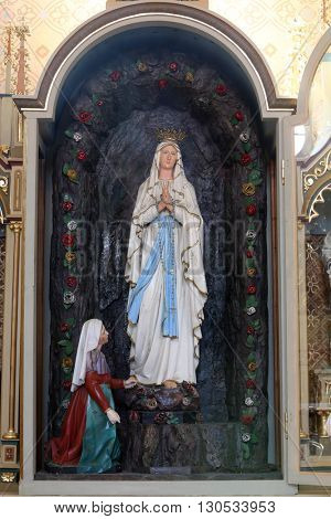 STITAR, CROATIA - AUGUST 27: Altar of Our Lady of Lourdes in the church of Saint Matthew in Stitar, Croatia on August 27, 2015