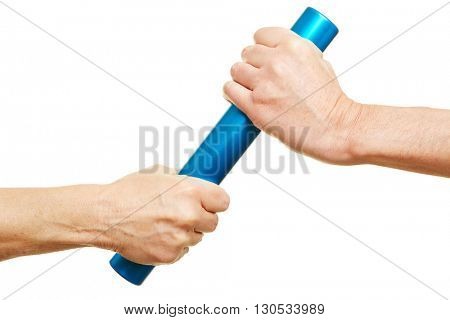Teamwork concept with two hands and a relay baton