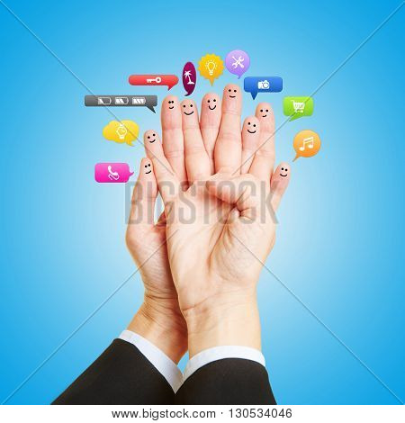 Group as smileys on fingers talking with many colorful speech bubbles