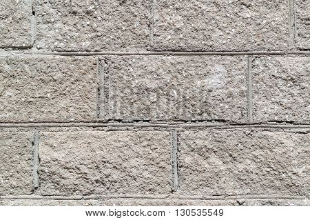Grey Concrete block wall texture background closeup