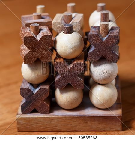 tic-tac-toe or noughts and crosses game in wooden stick standing