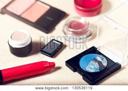 Makeup set of navy blue and rose pink eyeshadows, blusher, lip pencil, primer and lip balm