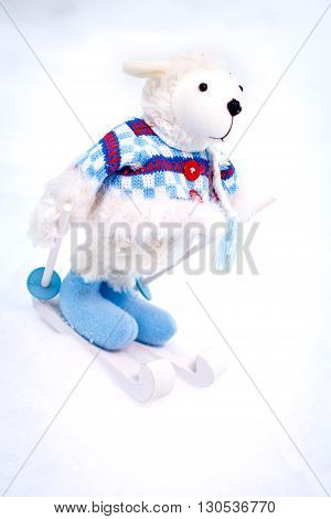 Fluffy cute soft toy white sheep skiing