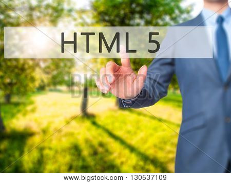 Html 5 - Businessman Hand Pressing Button On Touch Screen Interface.