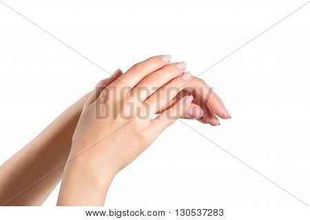 Female manicured hands isolated on white background