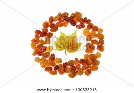 A raisin in the form of a circle isolated on white background.