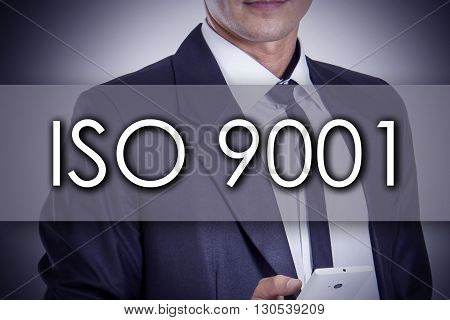 Iso 9001 - Young Businessman With Text - Business Concept