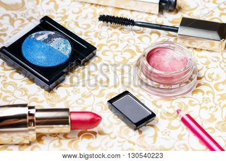 Makeup items of lipstick, lip pencil, eyeshadows, mascara