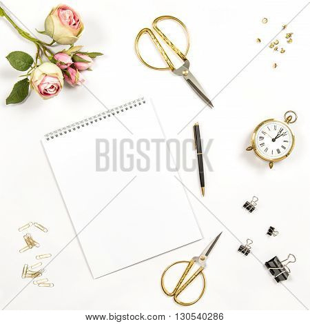 Sketchbook flowers office tools and accessories. Flat lay notebook top view