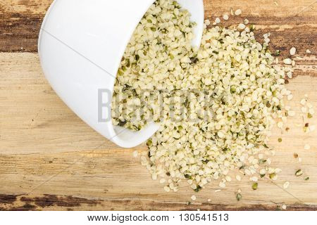 Blanched Hemp Seeds In Bowl, On Wooden Background