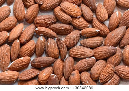 Many almonds without shell closeup background macro