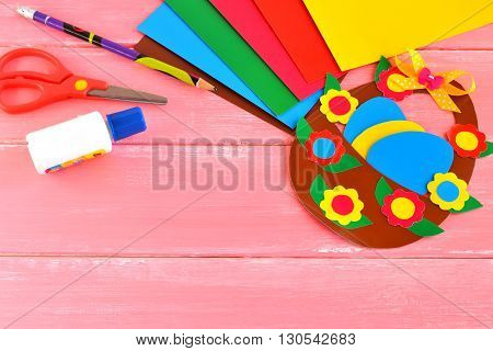 Sheets of paper, scissors, glue, pencil, Easter basket and eggs - set for children creativity