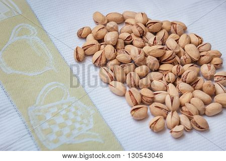 Pistachio nuts in a shell, salty, roasted on a table cloth