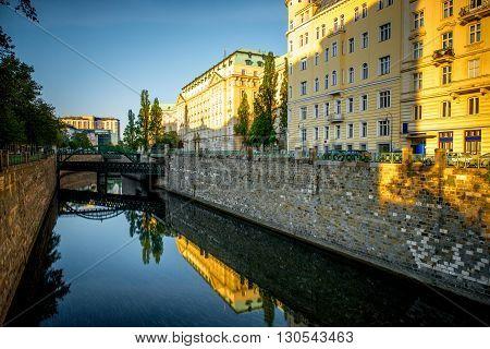 Water channel with Zollamtssteg bridge in residential district in Vienna