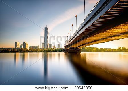 View on Donaucity with bridge in Vienna in the morning. Wide angle image with long exposure technic with glossy water and reflection