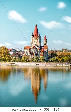 St. Francis of Assisi Church with reflection on the water in Vienna