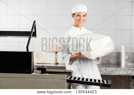 Female Baker Holding Packed Bread Loaf