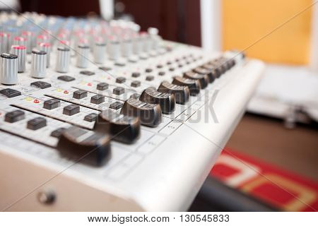 Buttons On Gray Music Mixer In Recording Studio