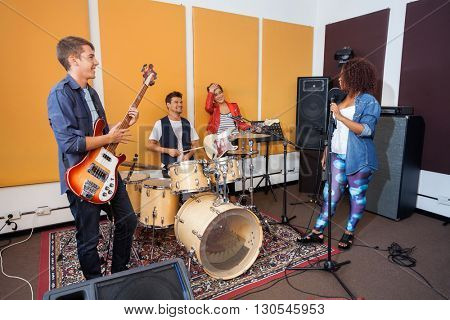 Band Members Practicing In Recording Studio